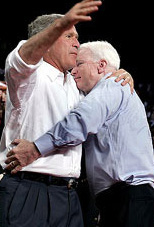 Bush and McCain hugging.